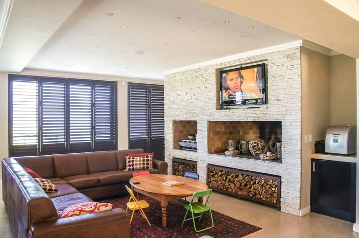 Living room with built-in fireplace/braai for relaxing and spending time with friends and loved ones.