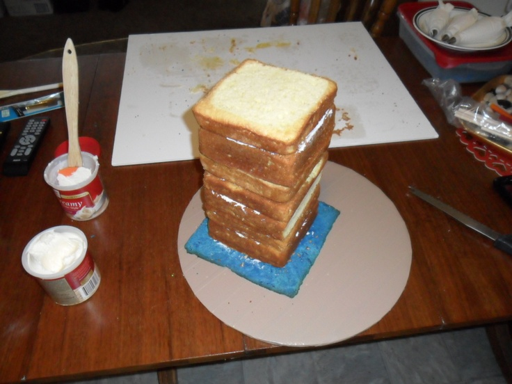 Cake Images Dow : The makings of the Tardis cake. Stacked pound cakes on a ...