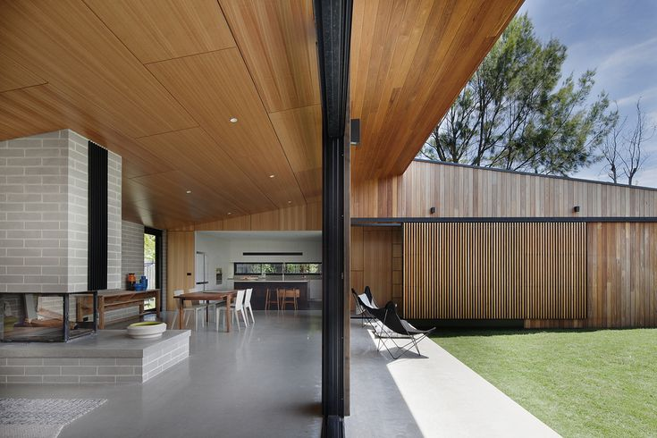 Like the flow to outside, and the separation of living areas created by the fireplace.