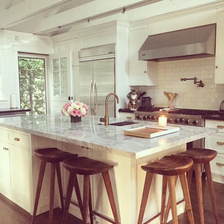 White kitchen with large island - Cupcakes & Cashmere
