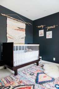 Tour a baby girl's modern bohemian nursery painted the prettiest shade of navy featuring the charm wool rug from west elm!