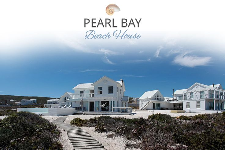 PEARL BAY BEACH HOUSE, Yzerfontein Self Catering Accommodation on the Cape West Coast - White wooden Clapboard holiday home set in the sand on the beach and with superb sea views. 3 bedrooms in the main house with separate honeymoon suite with own entrance. DStv, WiFi, indoor fireplace, braai area, swimming pool. Sleeps 6 and 2 respectively.