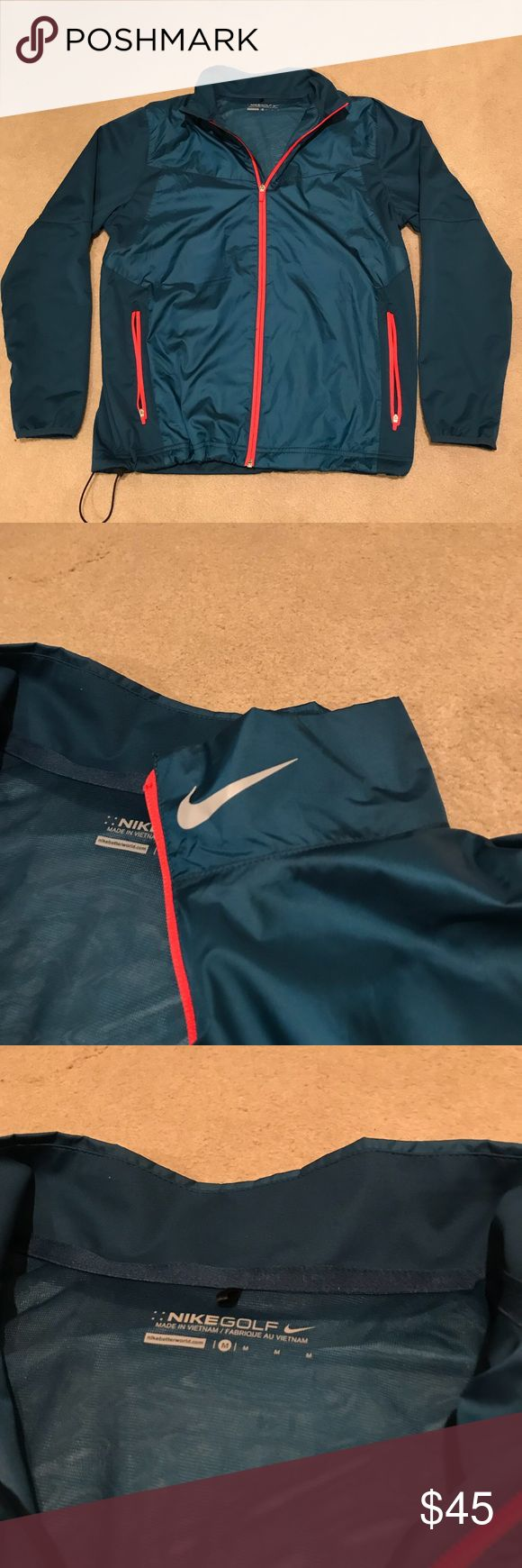 Nike Golf Shield Waterproof full zip Jacket Full zip Nike shield golf waterproof jacket. Turquoise color with orange zipper linings. Two front pockets and a draw string waist. Reflective Nike logo on the collar. Nike Jackets & Coats Windbreakers