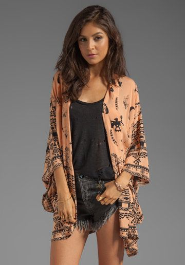 This Boho Tribal Kimono in lovely peach is the perfect go-to fall coverup.