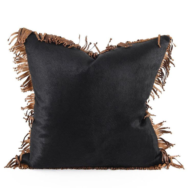 As Shown: Mustang Cowhide Fringe Pillow Size: 18 x 18 inches Material: Cowhide Color: Black, Saddle Brown Trim Description: Style runs free when a sophisticated hair-on cowhide pillow gets a touch of the wild with a hand-knotted fringe edge in contrasting leather. Mix it with colorful textiles or other leathers - it is as at home in your sleek townhouse as it is on the rustic range. Each pillow is individually created for you by our artisans in India and fitted with a feather and down…