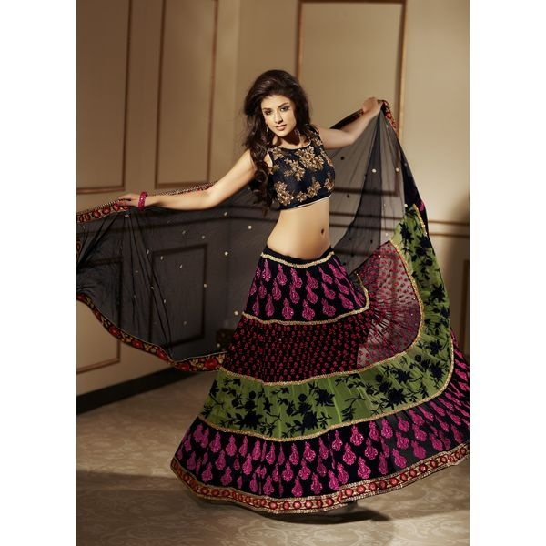 Black Embroidered Party Wear Lehenga Saree.This party wear lehenga saree is beautified with resham thread embroidered buttas studded with beads with embroidered border and shimmer patch patti,add extra glam to the saree.