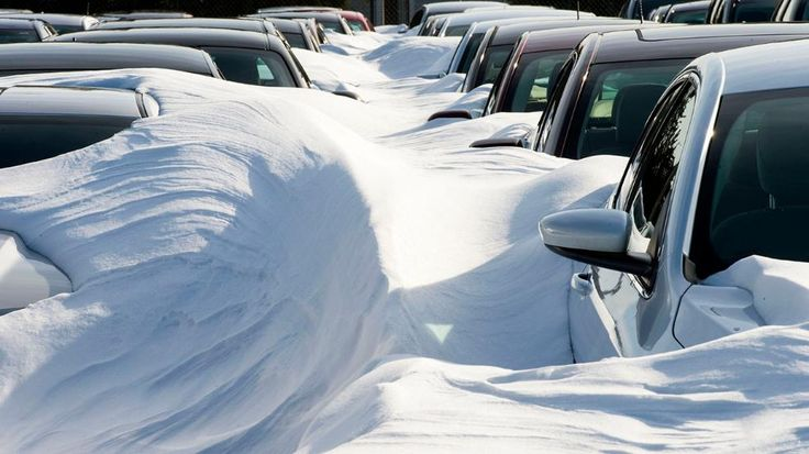Rental cars are buried in snow, at Dulles International Airport (IAD) January 25, 2016, outside Washington, DC, in Sterling,Virginia after Winter Storm Jonas. (Paul J. Richards/ AFP/Getty Images)