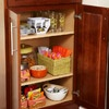 Kids' pantry, with plastic dishes, napkins, and snacks