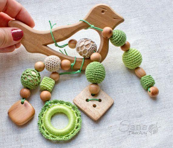 Crochet motor skills trainer stroller toy by SanaFiberArts on Etsy
