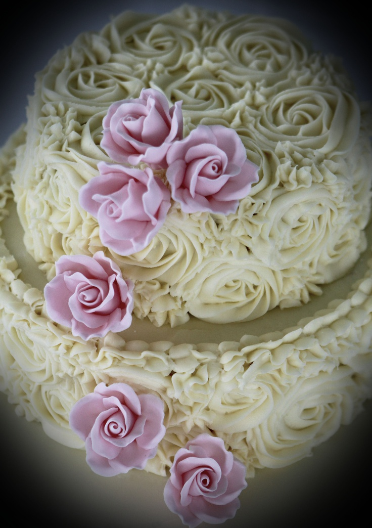 Two Tiered Red Velvet Cake With Rose Piped Cream Cheese