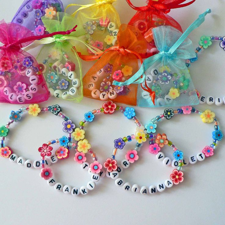 LOVE this for a favor - Kids Personalized Luau Party Favors Flower Lei Bracelets Children's Jewelry Name Bracelet Baby Child Kid Toddler Garden Party Clay. $4.25, via Etsy.