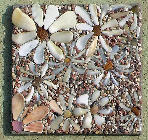 shell flowers mosaic like on tile + DIY + really easy to do this..make trivet or hang..or even larger on table top..or lamps  + Beach Cottage Decor + Coastal Living + Nautical