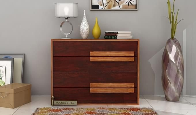 Add some storage space to your house with this beautiful chest of drawers from #Woodenstreet. It is made from Sheesham wood and has a dual tone of elegant mahogany finish and #beautiful honey finish. #furniture #India