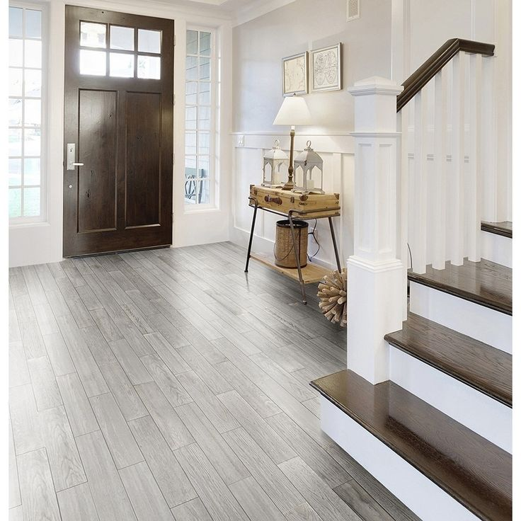 Upscale Black And White Kitchen With Gray Wood Porcelin Flooring