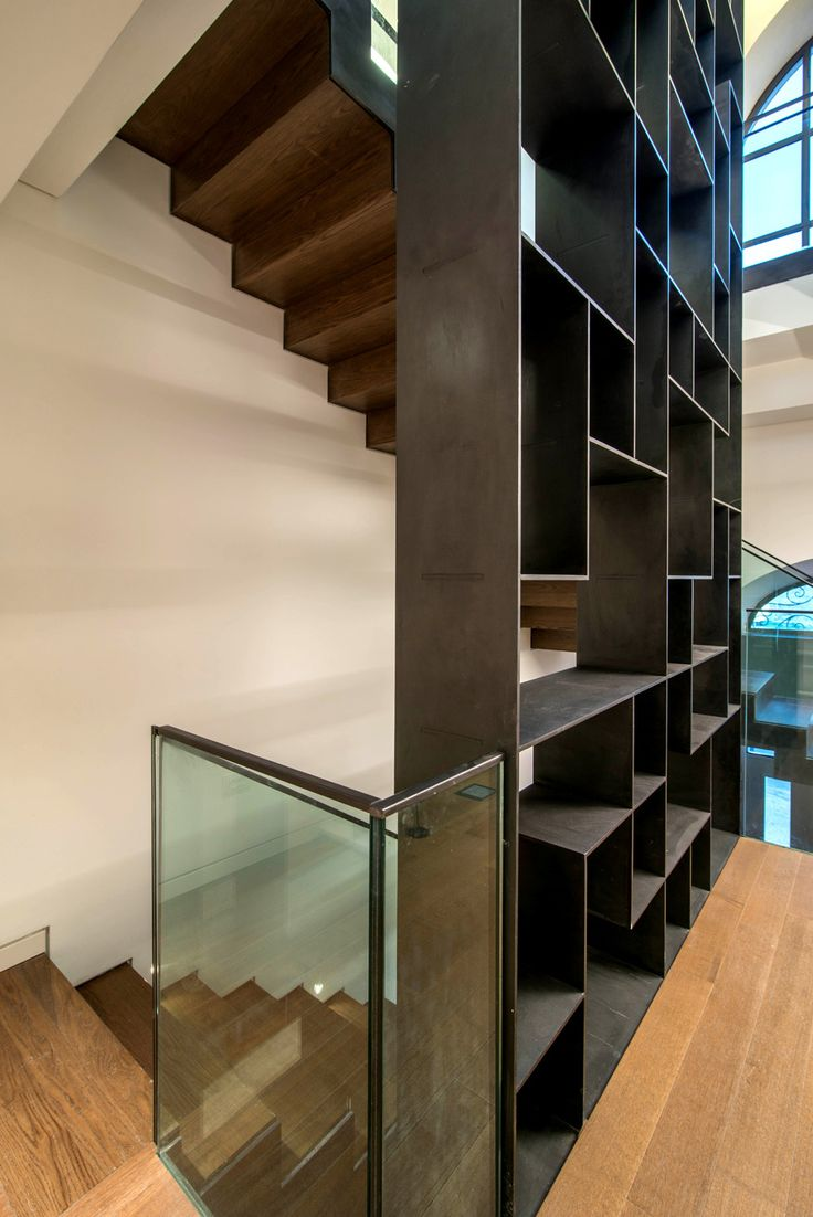 Modern Stairs // Bookwall with wrapping stair at the Mamilla Residence | Matti Rosenshine Architects; Ilan Nahum | Archinect