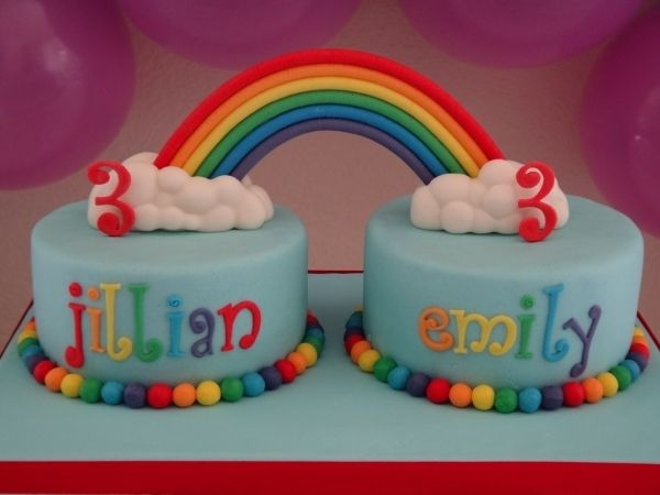 Perfect cake for twins...  they still get one each, but the rainbow joins them together.  This is a cake to make you smile!