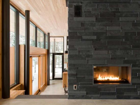 Stone fireplace - love the texture, but would prefer white. No hearth or mantle. May prefer simple mantle.