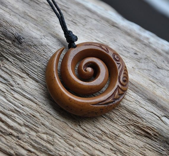 Bone Koru Handcarved & naturally stained by JackieTump on Etsy, $75.00