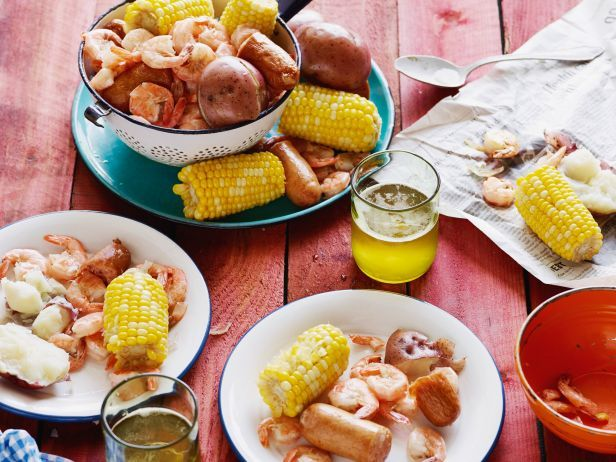 Low-Country Boil : Trisha's Louisiana-style seafood boil makes a perfect summer party spread. She boils shrimp with sausage, corn, potatoes and onions for an easy feast that feeds a crowd.