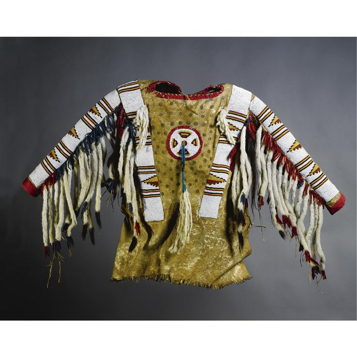 A Blackfoot Beaded and Fringed Hide Man's Shirt | lot | Sotheby's, with ermine tails