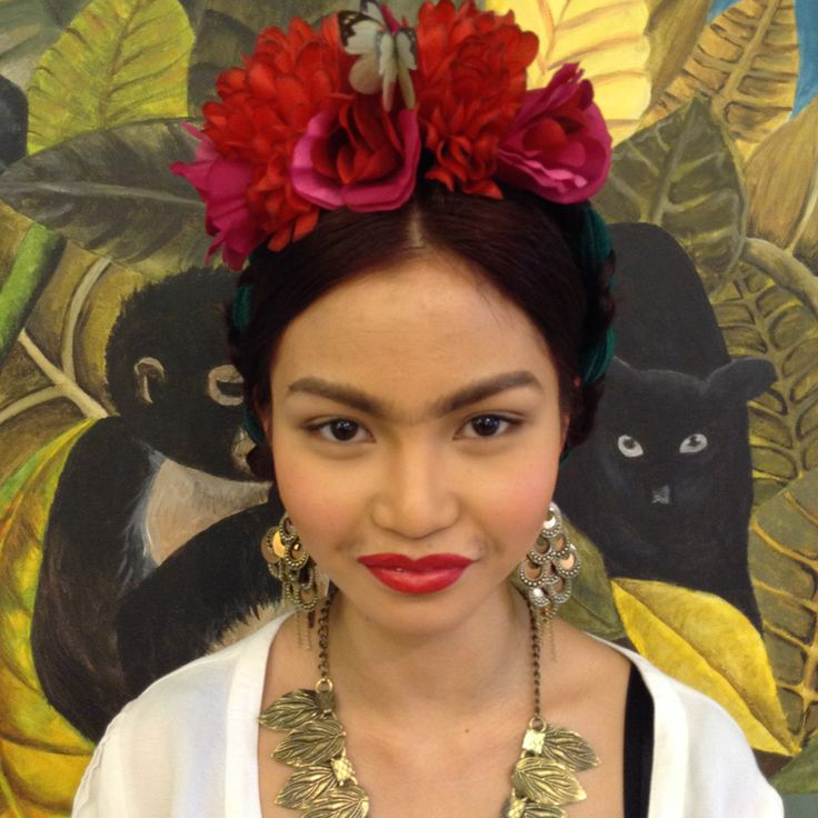 Frida Kahlo look, I also painted the back drop and made the headpiece
