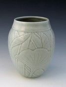 Bas relief designed porcelain vase, high fired with celadon glaze