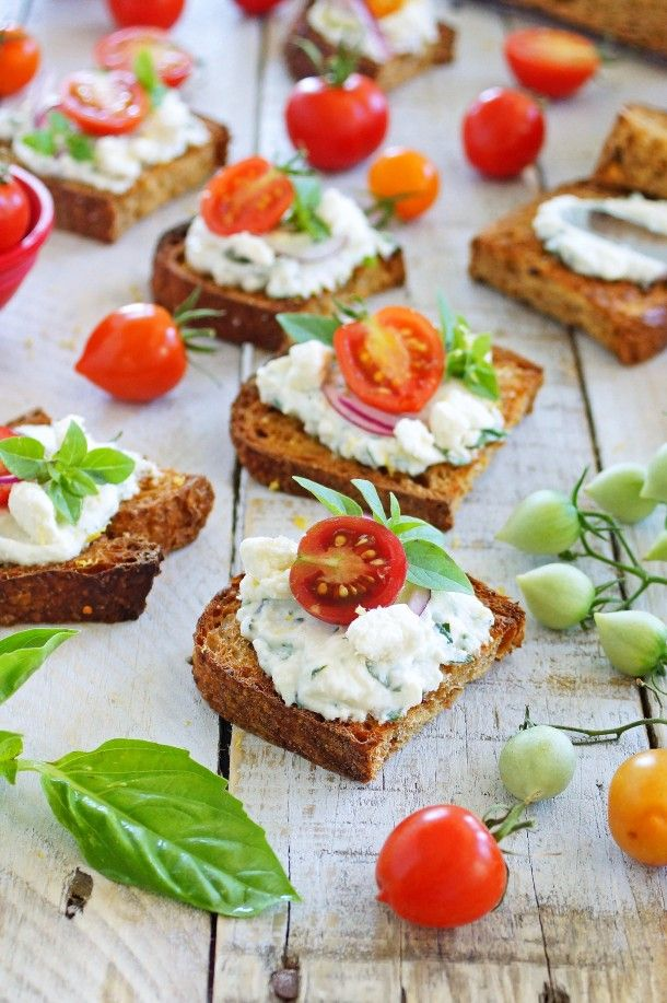 Herbed Ricotta Spread with Feta Cheese and Cherry Tomatoes on Multigrain Toasts