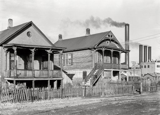 """Live Better Electrically: 1938   November 1938. """"Houses near the Nebraska Power Company plant, Omaha."""" Photo by John Vachon for the Resettlement Administration. View full size."""