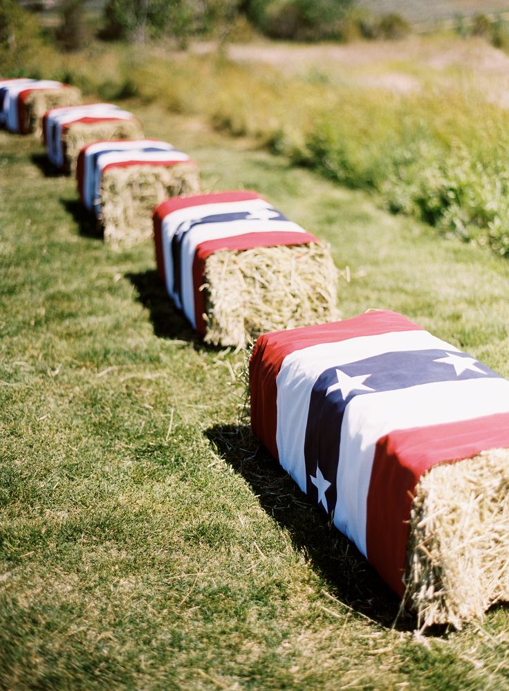 Got extra hay laying around? Dress it up! Cheap way to add some decor to your land party! http://www.homedit.com/simple-4th-of-july-decorations/