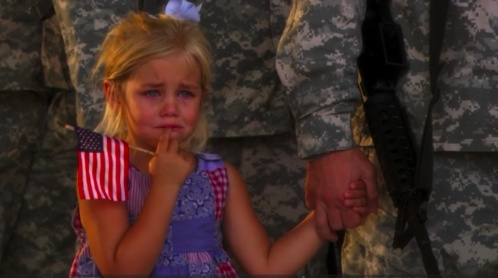 Story behind this? Her dad was leaving on a 2 year deployment. She was crying, and wouldn't let go of her dad's hand, even when he stood in line, saluting. No one had the heart to break them apart.