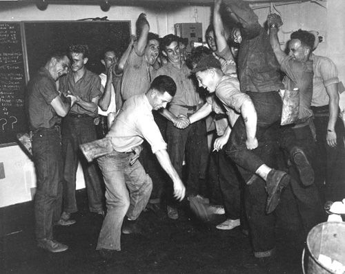 Sailors dance aboard the Bougainville