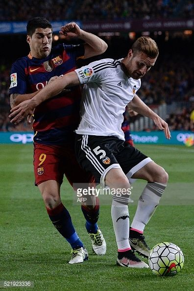 Valencia's German defender Shkodran Mustafi vies with Barcelona's Uruguayan forward Luis Suarez during the Spanish league football match FC Barcelona...