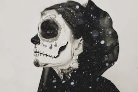 Mexican skull in a hood