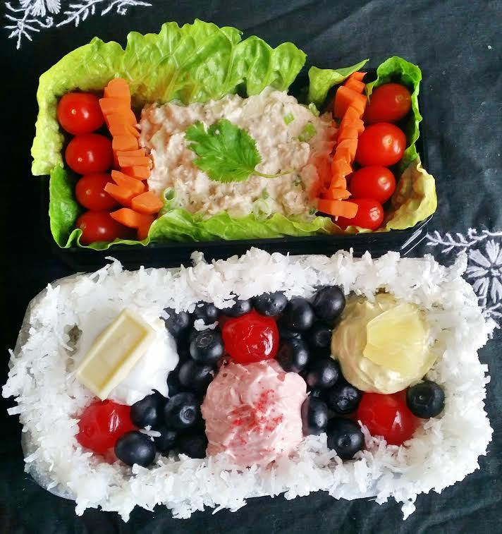 #103 Meriam USA This Bento consists of beautiful light and refreshing main dish of tuna salad and veggies to save you plenty of room for dessert! The dessert consists of three different cakes (red velvet, vanilla, lemon) topped with white chocolate,  red sprinkles and pinnapple laying on a sweet bed of coconut, but don't worry there's plenty of fresh fruits so it has to be healthy,  right?
