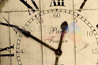 stock photo of horizontal closeup sepia image of outdoor clock in paris france