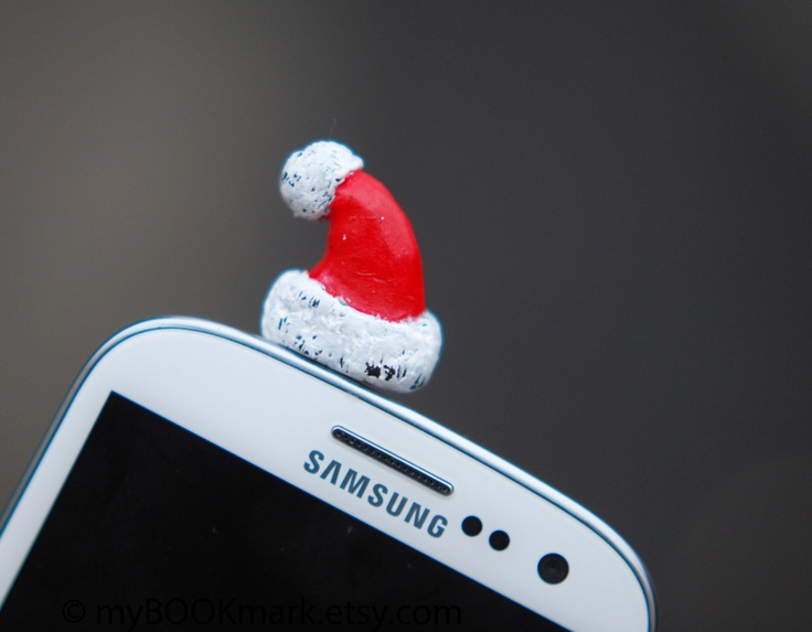 Santa hat Cell phone accessory. Christmas plug for earphone jack. Miniature Fits iPhone 5 4 4s ,iPad ,Samsung  s2 s3, 3.5mm output. for all. $9.50, via Etsy.
