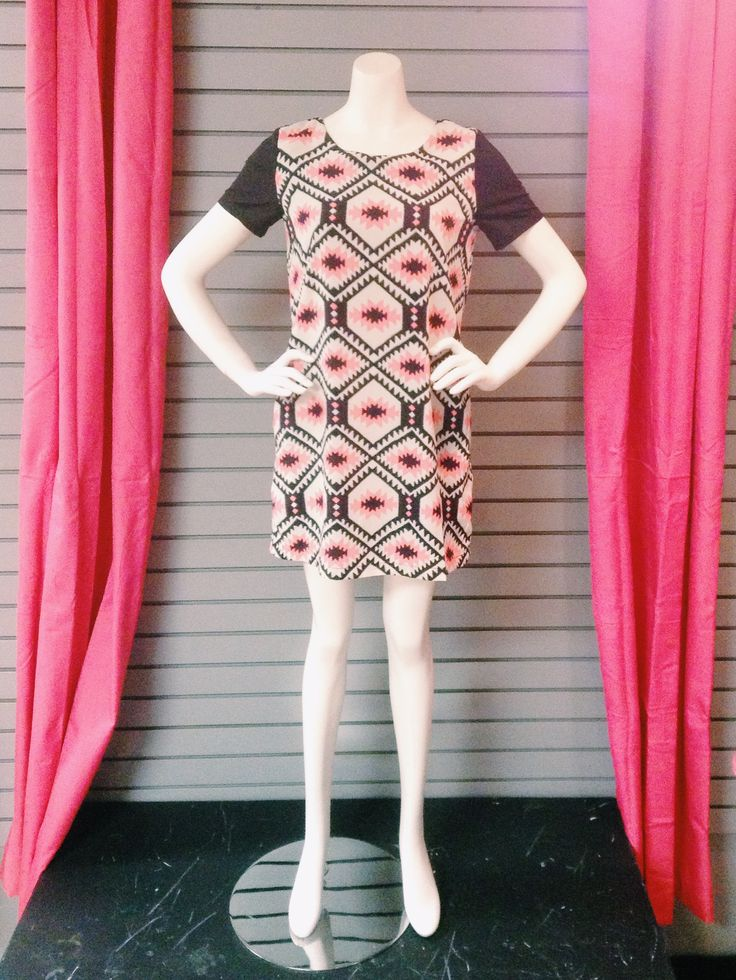 Mod feel. Love this print! Centre location.