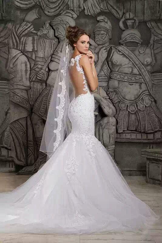 White mermaid train dresses