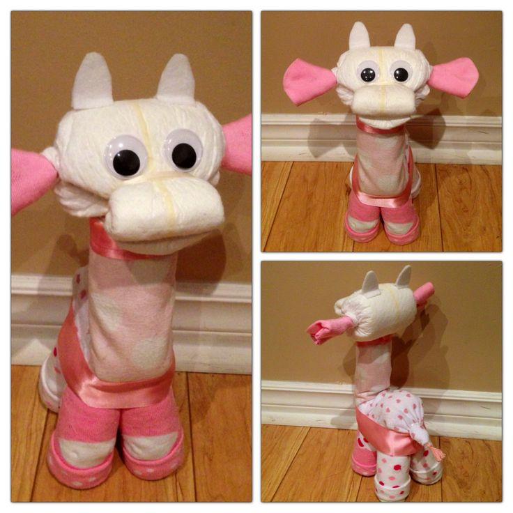 The design in this image is subject to copyright protection and is the intellectual property of Viva Diaper Cakes. Pink giraffe diaper cake animal. Unlike some diaper animals, all diapers, washcloths and socks are 100% useable upon disassembly! Tutorials coming soon. Follow this board for updates. Like my page on Facebook if you like my diaper animal designs. www.facebook.com/vivadiapercakes
