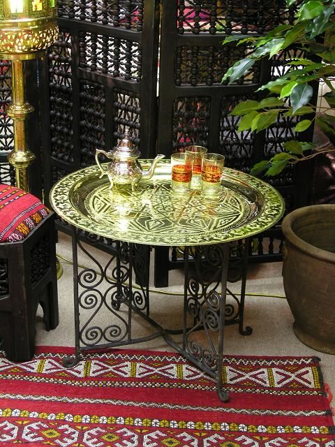 60cm Moroccan brass tray with metal legs. http://www.maroque.co.uk/showitem.aspx?id=ENT01305&s=10-10-030