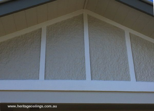 The Roughcast pressed metal panel is used on this gable end. Find out more about this aluminium panel here: http://www.heritageceilings.com.au/tempat/roughcastp.php