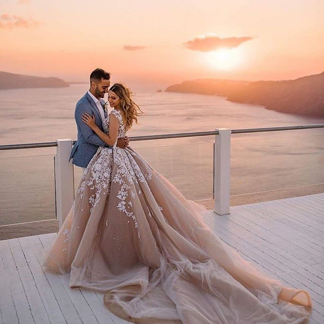 WOW, just wow! Our jaws hit the floor when we spotted this breath-taking image over on @loverly so we just had to share! Dress by @steven_khalil // Hair by @hairstylist_lizzieliros // Make up by @imansartistry // Planned by @santoriniglamweddings // Venu