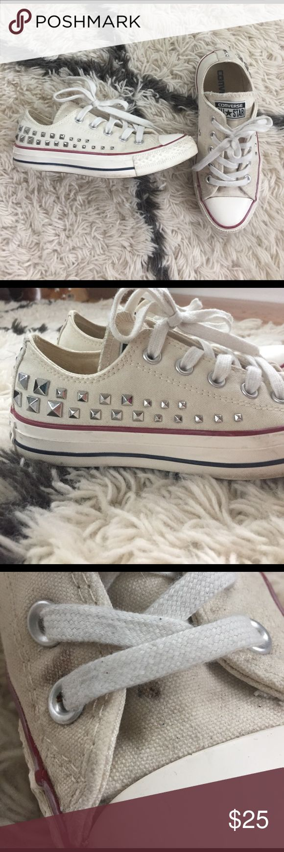 Studded converse Light cream colored converse low tops with silver studs on the sides, size 5 but fit more like a 5.5/6, worn just a few times, two tiny spots on the left shoe (see photo), but would probably come right out with a bleach pen. Converse Shoes Sneakers