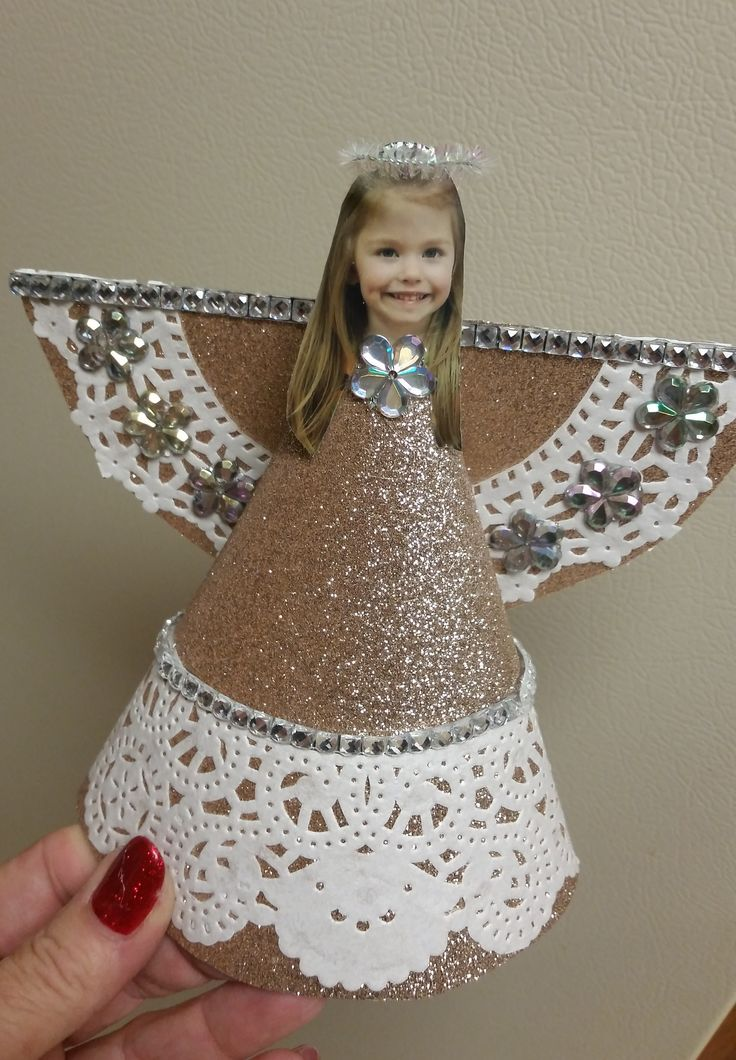 Christmas angel ornament with child's photo.