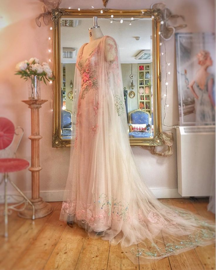 Blush tulle and silk chiffon with bespoke embroidery…a romantic gown and cape …