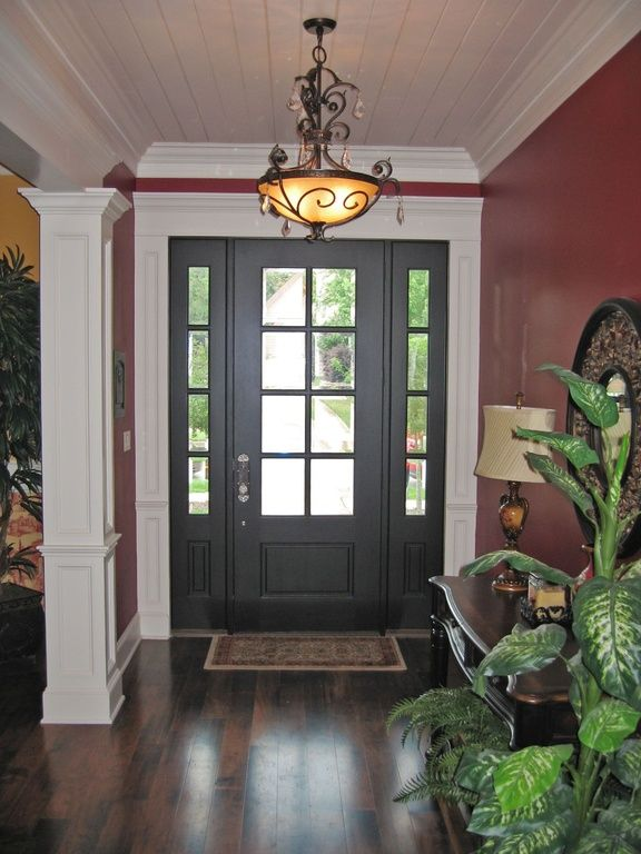 Country Entryway with Glass panel door, flush light, Columns, Bamboo floors, Crown molding, High ceiling