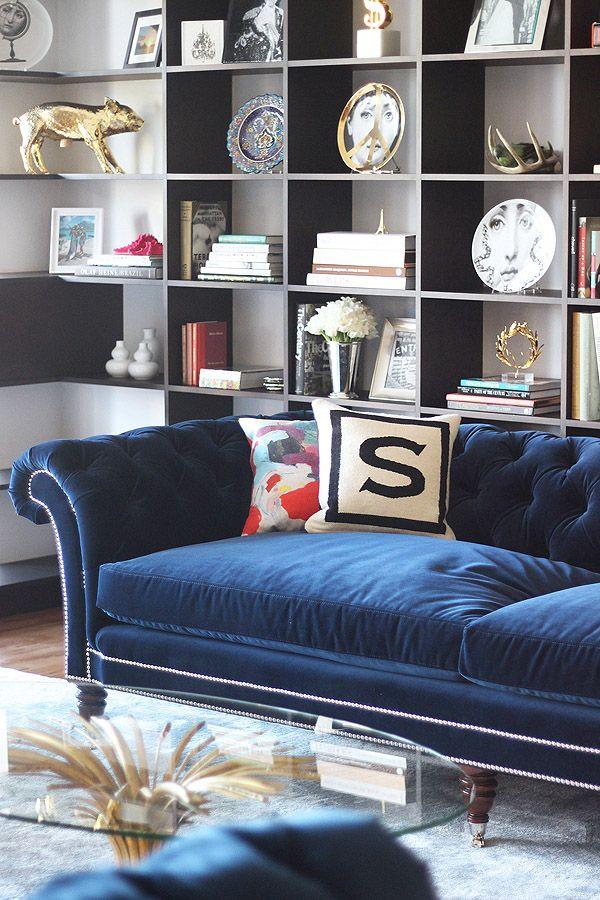 Soho NYC loft Tamra Sanford blue velvet tufted sofa bookshelves