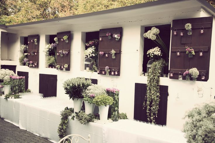 Buffet decorations with flowers and greenery compositions. Natural and relax look