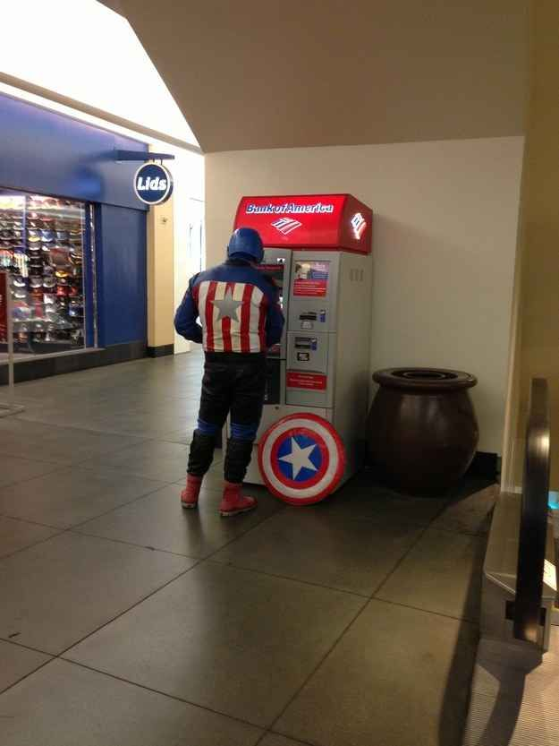 Captain America using a Bank of America ATM because of course that's where he keeps his American money. | 18 Photos That Will Make You Proud To Be 'Murican