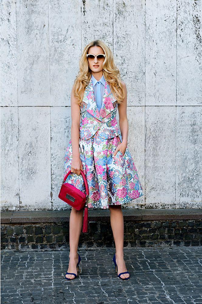 MFD silk chiffon sleeveless blouse; brocade waiscoat; brocade skirt; leather pouch with tassel.
